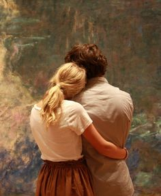 A couple admires the color and texture of Monet's Water Lilies at MoMA, New York  this is so perfect