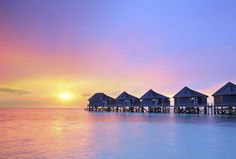 The Maldives | A private villa standing over crystal blue waters; days that end with orange sunsets over the ocean horizon; a glistening turquoise sea and white sands; The Maldives is the world's best backdrop for the perfect vacation.