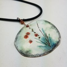 This delicate painting creates a sturdy necklace. Formed copper was shaped, enameled, painted and strung on a thick black silk cord. Measures 2 across, 2 high. cord length One of a kind Handmade in the USA by Jomama Enamel Jewelry, Copper Jewelry, Jewellery, One Design, Handmade Art, Handmade Necklaces, Polymer Clay, Delicate, Jewelry Making