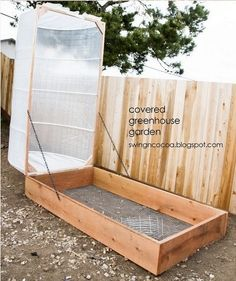 Covered Greenhouse Garden - LIke the hinges and the idea to use gardening fabric. This variation is much taller than the box design and will allow cages for tomatoes. Also, she says her updated model held up against the wind - a big issue here!