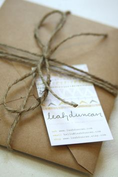 give out xmas cards and holiday booklets this way - packaging with business card