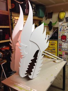 Chinese dragon head built for my wife's classroom. By Todd Van Fleet. Made with cardboard, foam core and lots of hot glue. Painted with spray paint. The handles are PVC so kids can hold it over their head.