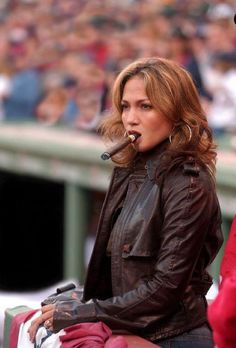 JLO looking hot with a #Cigar!