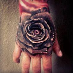 Rose Hand Tattoos Eye rose hand tattoo ink