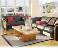Ekornes Manhattan sofa and loveseat in Paloma black and