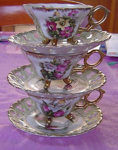 Sweet little footed cups, pierced saucers with yummy colours and gold rimmed . tea anyone?