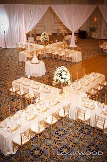 I love the table layout!  You'd save on centerpieces if you did it right :)