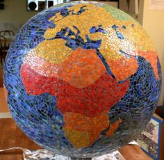 Globe made for Microsoft to mark their 30 years of Gifting Matching Campaign. The Globe will live in the Executive Briefing Center - It spins 3 different axes on the beautiful stand created by Artech for this Globe. Seattle Mosaic Arts