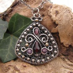Sterling Silver Pendant Wire Wrapped Purple Red Czech Glass Handmade Necklace. $140.00, via Etsy.