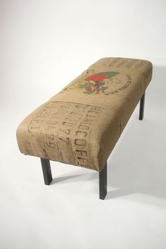 The bench is upholstered with reused coffee bean burlap sacks, these bags came from Costa Rica. Three panels from the coffee bags cover the bench.