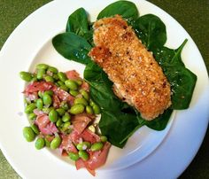 7000 Year Old Grain for Dinner: Lemon pepper marinated chicken breasts breaded in quinoa flakes and red pepper flakes over a bed of baby spinach.  Served with a warm prosciutto salad comprised of shelled soy beans, shallots, lightly sauteed prosciutto, lemon juice & olive oil