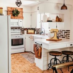 Vent hood cover over microwave White cabinets Shiplap island breakfast Hanging cutting boards Farmhouse cottage style Cozy kitchen Cozy Kitchen, Kitchen Redo, Kitchen Ideas, Kitchen Colors, Kitchen Inspiration, Diy Breakfast Bar, Kitchen With Breakfast Bar, Diy Kitchen Cabinets, Kitchen Remodeling