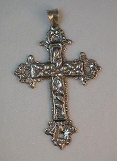Vintage Sterling Silver Repousse Cross Pendant    http://www.ultimateadornment.com/shoppingcart.php?item_id=catalog_-1958