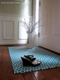 I am so doing this!! (Happy Dance). DIY Fabric Floorcloth via I Am Momma - Hear Me Roar. Sturdy rubber runner mat with traction from Home Depot, favorite fabric, spray adhesive, duct tape, and polyurethane. Brilliant!