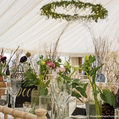 A Wilde Bunch marquee design on New Years Eve Table centres overlooking a splendid marquee dividing arch Marquee Wedding, Table Centers, New Years Eve, Garland, Wedding Flowers, Arch, Wedding Ideas, Weddings, Table Decorations