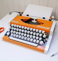 Vintage Olympia Traveller De Luxe Typewriter: Someday I want to write children's books. I'm going to buy a typewriter just like this when I decide to make the leap.