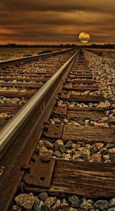 Chocolate brown evening train track moon night