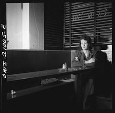 Girl Sitting Alone in the Sea Grill  Esther Bubley  1943