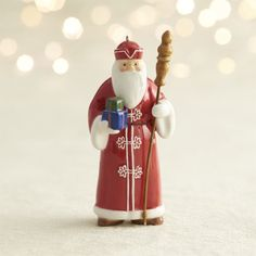 """From Crate & Barrel: Celebrate Christmas around the world with our exclusive collection of 13 Santa ornaments.  Each hand-painted, ceramic Santa is intricately detailed with his native country's traditional Christmas attire and accessories.  The country name and the year 2014 are marked on to make a special addition to your ornament collection. Our Norwegian Santa is inspired by the traditional """"Julenissen,"""" a Christmas elf or gnome much like the traditional Santa Claus or St.  Nicholas."""