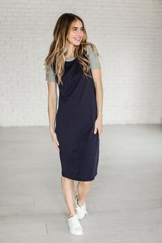 The ultimate in Summer-wear. It is comfy, modest, and stretchy! Navy Body with Heather Grey Accents. Material is heavy enough to avoid a slip, and stretchy enough for maximum comfort. Fabric content: