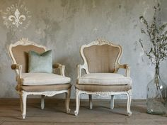 Lovely armchairs with beautiful contrast with the white coloring of the frame, the burlap upholstery, and the pale fawn cushion.