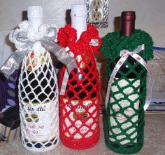crochet wine bottle covers Great gifts to have for the unexpected guest great for any occasion I always keep a couple handy around the holidays made from crochet cotton thread and will stretch to fit most wine bottles Holiday Crochet, Crochet Christmas Ornaments, Crochet Gifts, Christmas Crafts, Crochet Decoration, Crochet Home Decor, Homemade Crafts, Diy And Crafts, Wine Bottle Covers