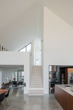 An Amazing Home Surrounded by Farmland with a Natural Landscape 2019 White stairs leading up to a beautiful open loft. The post An Amazing Home Surrounded by Farmland with a Natural Landscape 2019 appeared first on Apartment Diy. Vintage Industrial Furniture, Industrial House, Industrial Closet, Industrial Bookshelf, White Industrial, Kitchen Industrial, Industrial Apartment, Industrial Bedroom, Industrial Office