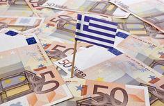 Flag of Greece sticking in european banknotes (Photo: Per Bengtsson/Shutterstock)