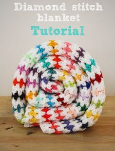 How-To: Diamond Stitch Blanket. I can't crochet, but I love this colorful blanket!