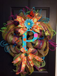 A personal favorite from my Etsy shop https://www.etsy.com/listing/183554056/monogram-burlap-spring-wreath