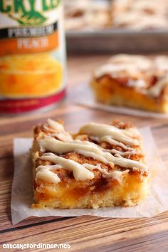 Peach Pie Sheet Cake Bars with Cinnamon Streusel and Cream Cheese Icing. You can make these delicious bars with any type of pie filling - Blueberry, Raspberry, Cherry and Strawberry would all be amazing!
