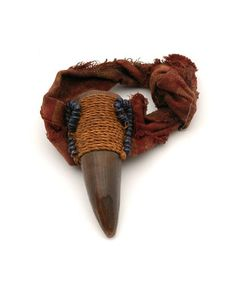 Africa | Amulet ~ 'ody' ~ from Madagascar | 20th century | Horn, glass beads and fabric
