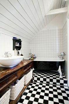 two reasons y I like this- firstly the black and white checkered floor and secondly- the huge baskets under the sink- looks pretty and hides the mess. Flickr - Photo Sharing!