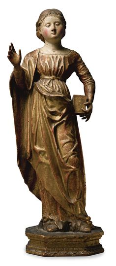 An Italian painted and gilt wood figure of Mary Magdalene, circle of the Master of Trognano, late 15th century, Lombardy