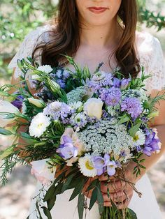 Purple and white wildflower wedding bouquet with daisies, Queen Anne's lace, scabiosa and lisianthus