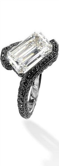 de GRISOGONO ♥✤A one-of-a-kind high jewellery ring with an emerald cut white diamond ring of 7.56 carats surrounded by black diamonds