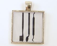 Dental Tools Pendant - Black White Square Resin Medical Professional Dentist Hygienist Jewelry. $9.00, via Etsy.