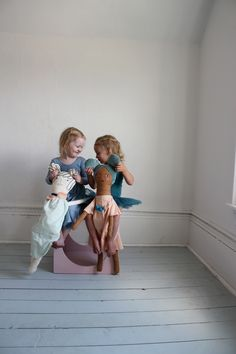 girls and their dolls