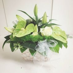 White and Green Antirrhinum and Lily basket arrangement.