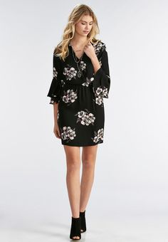 Take center stage in this enchanting blouson dress, featuring a dark ground floral print, surplice neckline and double flounced sleeves.        3/4 sleeves     Front snap closure     Shell: 100% rayon     Lining: 100% polyester     Machine wash     Imported