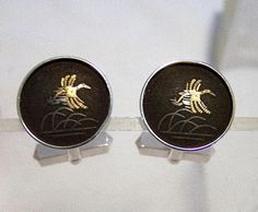 Mid Century Amita sterling silver round cuff links Hunting scene, flying mallard duck over marsh Damascene technique, black with silver and gold design Signed Amita sterling 5/8 inch diameter Very good vintage condition, shows no wear  International buyers welcome, over charges are automatically refunded Please visit my mens jewelry section for more cuff links Priority shipping is optional 92116  Credit cards and Paypal accepted