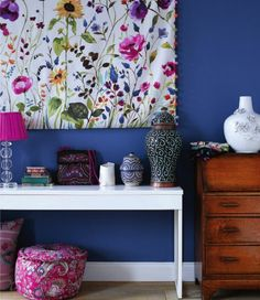 How gorgeous are these fuchsia and green tones with that bold blue wall?