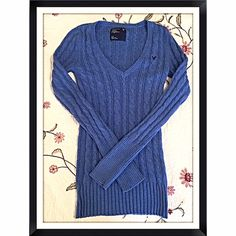 """American Eagle blue cable knit v neck sweater American Eagle blue cable knit v neck sweater. Soft cotton blend material (not itchy!) Measures approx 27"""" long, 24"""" arm length, & 17"""" across chest. Size small. Worn once- excellent condition! Bundle to save 10%!NO TRADES or lowballsI love reasonable offers! Please make one using the offer button American Eagle Outfitters Sweaters V-Necks"""
