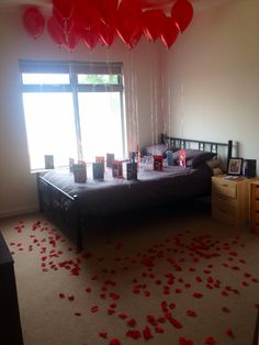 One year anniversary surprise for my boyfriend. 20 balloons over his bed attached with 20 cards. Each card has a different photo of us with one reason as to why I love him written around each photo. Very cute idea!