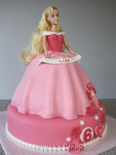 Sleeping Beauty cake tuffed white with pink top with roses like