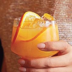 Whiskey Sour Punch Recipe - 1/3 cup sugar   1/3 cup water  2 1/2 cups refrigerated fresh orange juice   2 cups bourbon  1/2 cup fresh lemon juice (about 3 large lemons)  3 cups chilled club soda   Fresh orange slices (optional: