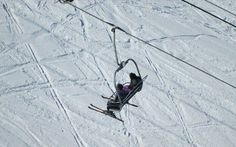 Skiers on ski-lift