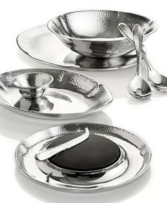 Set your table with pebbly and polished aluminum Lenox serveware