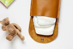Make this simple leather diaper clutch using this really easy tutorialn