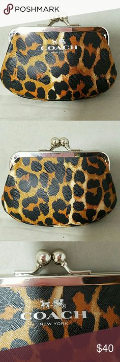 """COACH Silver Frame Cheetah Kiss Lock Coin Purse Brand: Coach  Item: *Silver Frame Kisslock Coin Change Purse Bag *Not Sure if Cheetah or Leopard *PVC Exterior, Black Sateen Interior *Silver Horse & Buggy 'Coach New York'  Color: Brown, Black, Tan, Silver  Measurements: 5""""w (at widest) x 3.5""""h x .5""""d  Materials: PVC  Condition: Excellent, Like New Coach Bags"""